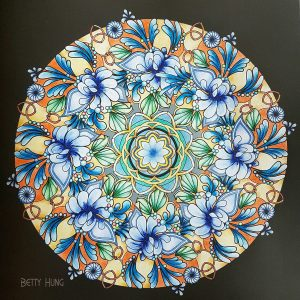 Coloring of 100 Glittering Mandalas by Betty Hung