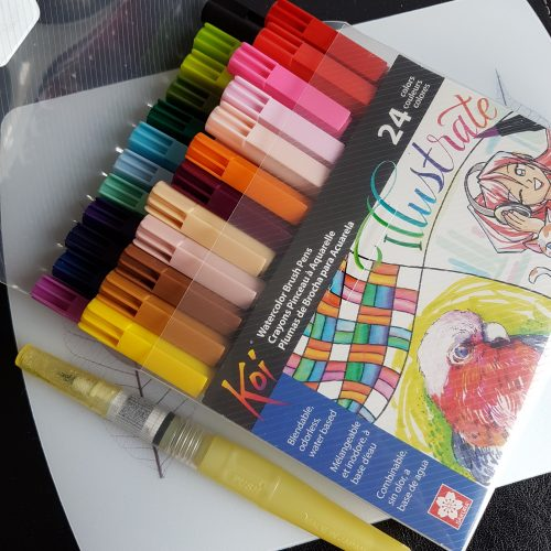 picture of a 24-color Sakura koi brush pen set and my water brush
