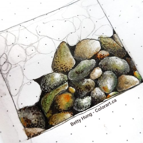 Coloring rocks in a sketchbook by Betty Hung